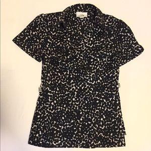 Black and white wrap-around blouse